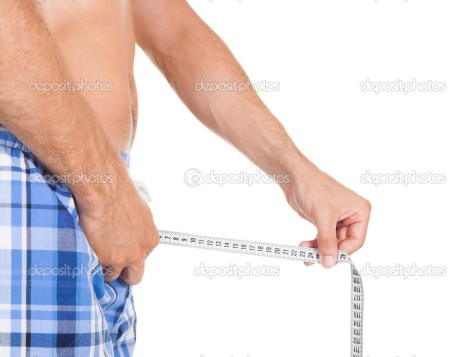 Man measuring his penis size